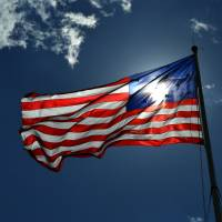 Backlit Storm Flag at Fort McHenry Art Prints & Posters by Bill Swartwout