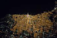 brightly lit night image of the largest city along