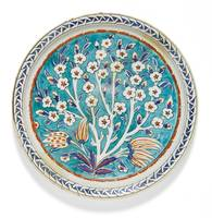 An Iznik polychrome pottery dish with a prunus tre