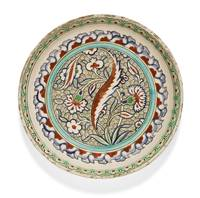 An Iznik polychrome pottery dish with a wave-scrol