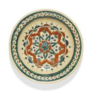 An Iznik polychrome pottery dish with a stylised s