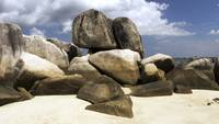 Rock formation on white sand beach in Belitung.