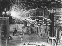 Nikola Tesla Sitting In His Experimental Station R
