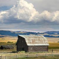 Big Sky Montana Log Barn by Roger Dullinger