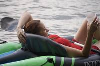 Woman Relaxing on Lake