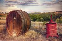 Wine Barrel and Grape Press Along a Country Road,