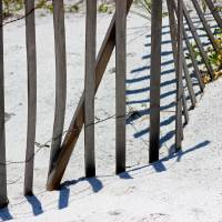 Beach Fence and Shadows  by Karen Adams