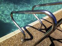 swimming pool ladder chrome reflection water shado