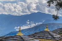 Stupa Roofs and Himalaya Mountains