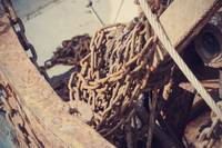 Rusty chains fishing trawlers net system.