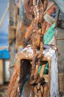 Rusty chains fishing trawlers netting system