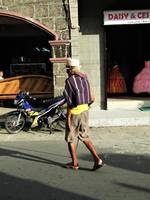 Elderly man crosses Taal street