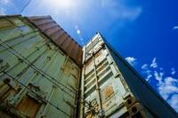 Used shipping containers stacked storage sun flare