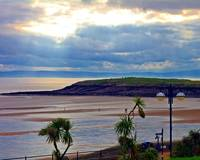 Sunburst Over Barry Island Beach