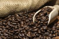 Roasted Coffee beans scoop hessian background