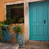 Teal Bicycle and Door in Rovinj Art Prints & Posters by Rae Tucker