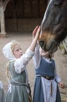 Tudor children in stables