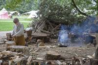 Tudor boy cutting wood