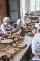 Tudor women in kitchen