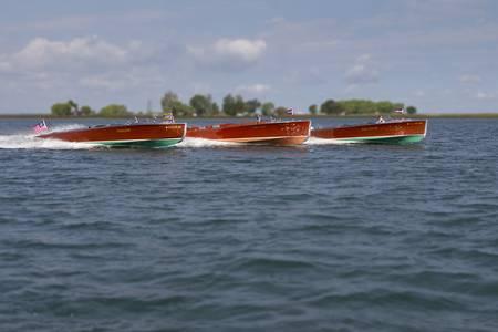 Three Racing Wood Boats