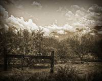 Old Western Gate And Storm Clouds by Kirt Tisdale