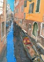 Gondola on a narrow canal in Venice