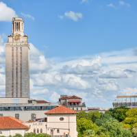 """UT Tower with Stadium"" by beecreekphotography"