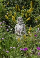 St Francis of Assisi in a garden
