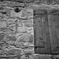 Stones Shutters and Shadows Black and White by Karen Adams
