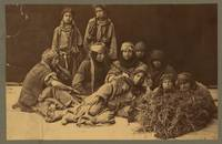 Group of Bedouin women huddled together, two stand