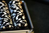 Black Poker Chips Organized In Case