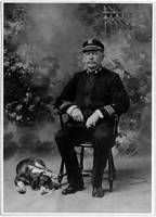 Commander Charles Thomas Hutchins, USN  Shown seat