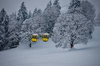 Yellow cable cars in the Swiss Alps