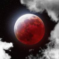 """Blood Moon with Clouds"" by cosmic_background"