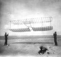 1901 glider being flown as a kite, Wilbur at left