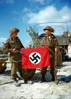 Canadian soldiers with a captured Nazi flag 1944