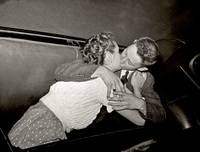 Couple kissing in rumble seat, Saugus drive-in the