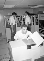 Inmates with an IBM computer and tape back-up syst