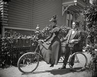 Man and woman with tandem bicycle