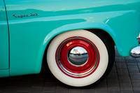 red wheel rim, white wall tire and chrome hubcap