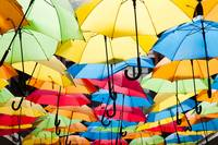 Colorful umbrellas hanging over the alley