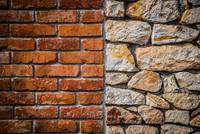 Red brick wall and stone wall background