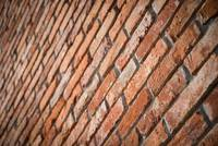 Red brick wall texture in perspective view