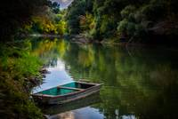 Boat alone on the calm river