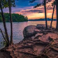 sunrise on lake jocassee south carolina by Alexandr Grichenko