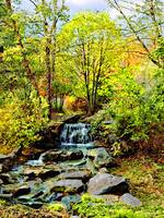 Small Waterfall in Autumn Park