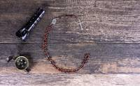 Flashlight, Compass and Rosary on Dark Wood (WC)