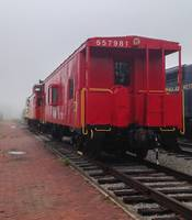 Vintage Red Caboose on a Foggy Day