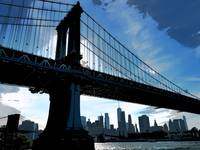 Manhattan Bridge Silhouette and NYC Skyline