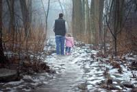 Father and Daughter Walking in the Woods